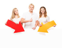 Young and happy teenagers holding colorful pointers Stock Photos