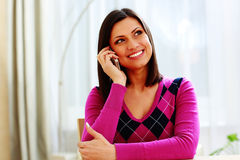 Young happy thoughtful woman talking on the phone Royalty Free Stock Photos