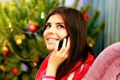 Young happy thoughtful woman talking on the phone Royalty Free Stock Images