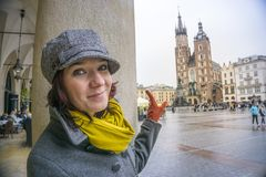 Happy woman pointing to the market square of Krakow, Poland Royalty Free Stock Photos