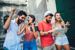 Happy tourists sightseeing in city royalty free stock photo