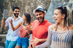 Young happy tourists sightseeing in city. royalty free stock photography