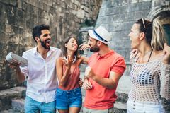 Young happy tourists sightseeing in city. They are having fun listening to music royalty free stock images