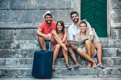 Young happy tourists sightseeing in city. They are looking at camera stock image