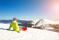 Young happy traveler hiking in beautiful mountains. Fantastic winter landscape royalty free stock images