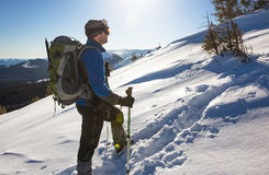 Young happy traveler hiking in beautiful mountains. Fantastic winter landscape Stock Photo