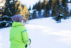 Young happy traveler hiking in beautiful mountains. Fantastic winter landscape Stock Photography