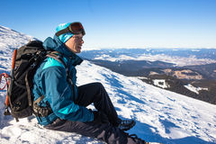 Young happy traveler hiking in beautiful mountains. Fantastic winter landscape royalty free stock photography