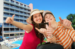 Young happy travelers. Couple travelers in summer clothes with luggage summer day Stock Photo