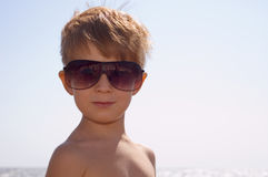 Young happy trendy with sun glasses Stock Photography