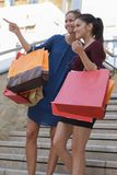 Young happy and wealthy women shopping. Teen Royalty Free Stock Images
