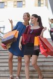 Young happy and wealthy women shopping. Teen Stock Images