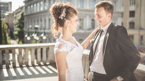 Young happy wedding couple bride meets groom on a wedding day. Happy newlyweds on terrace with gorgeous view. Royalty Free Stock Image