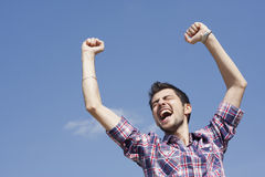 Young happy winner Royalty Free Stock Photos