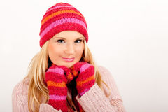 Young happy winter woman in pink gloves Stock Photography