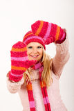 Young happy winter woman in pink gloves Royalty Free Stock Images