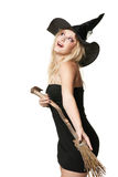 The  young happy  witch with a broom Royalty Free Stock Photo