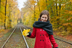 Young happy woman. In autumn park Stock Photography