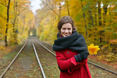Young happy woman. In autumn park Stock Photos