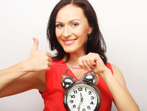 Young happy woman with alarmclock Royalty Free Stock Photography