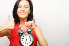 Young happy woman with alarmclock Royalty Free Stock Images