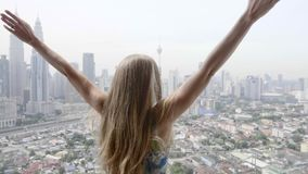 Happy Woman in Apartment. Young happy woman in apartment on the terrace raising her hands up and embracing the world. Freedom,vacation and happiness concept stock footage