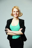 Young happy woman with arms folded Royalty Free Stock Image