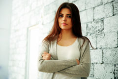 Young happy woman with arms folded standing Royalty Free Stock Photo