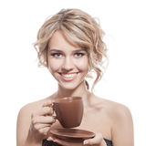 Young happy woman with an aromatic coffee in hands. Isolated Royalty Free Stock Images