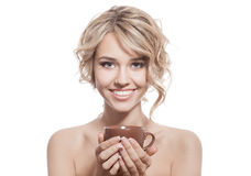 Young happy woman with an aromatic coffee in hands. Isolated Royalty Free Stock Photography