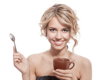 Young happy woman with an aromatic coffee in hands. Isolated Stock Images