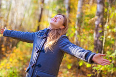 Young happy woman. In autumn park Stock Image