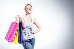 Young happy woman with bags Stock Photos