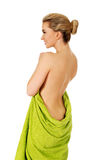 Young happy woman after bath or spa in green towel. Stock Images