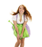 Young happy woman in bavarian dress handling with Stock Photo