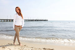 The young happy woman on a beach Royalty Free Stock Image