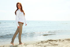 The young happy woman on a beach Royalty Free Stock Photos