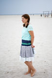 Young happy woman on the beach of St.Peter Ording, North Sea, Royalty Free Stock Images