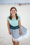 Young happy woman on the beach of St.Peter Ording, North Sea, Royalty Free Stock Photos