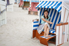 Young happy woman on the beach of St.Peter Ording, North Sea, Stock Images