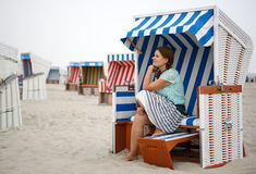 Young happy woman on the beach of St.Peter Ording, North Sea, Stock Photography