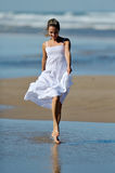 Young happy woman on the beach in summer Stock Image