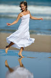 Young happy woman on the beach in summer Royalty Free Stock Image