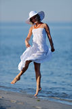 Young happy woman on the beach in summer Stock Images