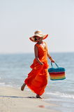 Young happy woman on the beach in summer Royalty Free Stock Images