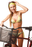 Young happy woman on bicycle Royalty Free Stock Photo