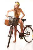 Young happy woman on bicycle Royalty Free Stock Image