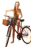 Young happy woman on bicycle Stock Image