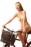Young happy woman on bicycle Royalty Free Stock Photos