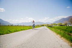 Young happy woman on bicycle Stock Images